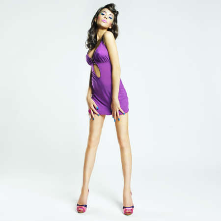 Fashion photo of young magnificent woman in lilac dress photo