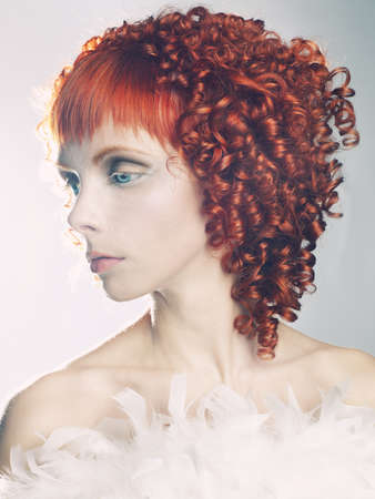 Portrait of a young angelic woman with red hair photo