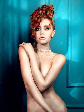 glam: Beautiful young girl with a white-red hair and fancy make-up Stock Photo