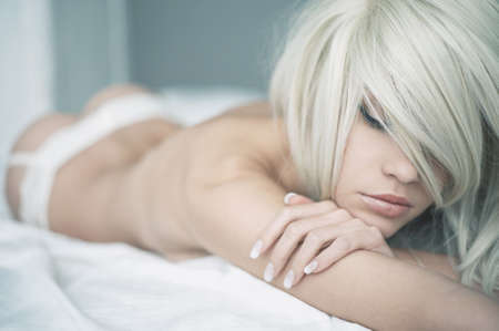 nude blond girl: Fashion portrait of young elegant woman in bed