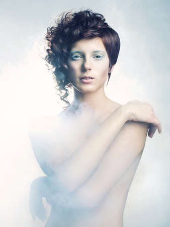 Picture a beautiful angelic woman in the fog photo