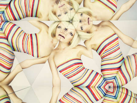 Bright young blonde in kaleidoscope of reflections photo