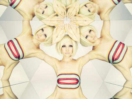 kaleidoscope: Bright young blonde in kaleidoscope of reflections Stock Photo