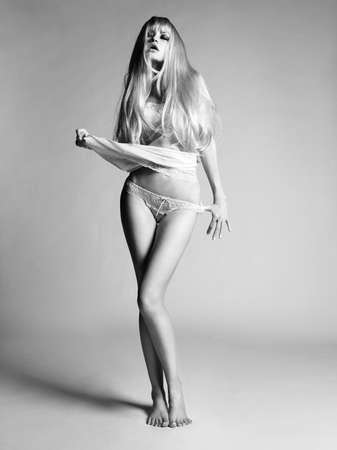 Studio fashion photo of sensual blonde lady