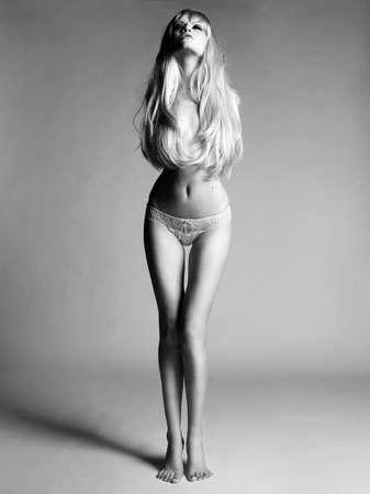 blond nude: Studio fashion photo of sensual blonde lady