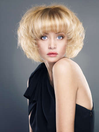 Beautiful young lady with bushy blond hair photo