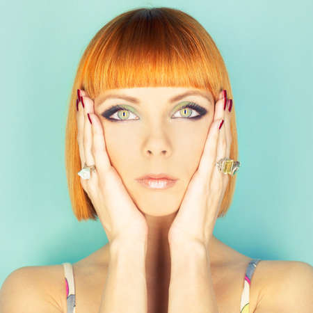 glam: Beautiful young lady with red-haired bob Stock Photo