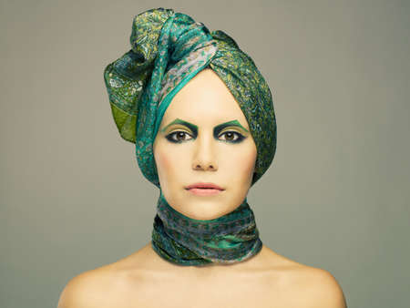Stylish lady in green turban with bright make-up photo