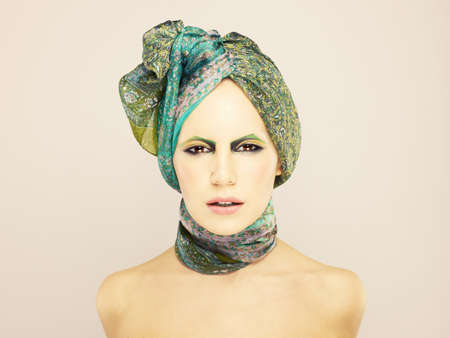 turban: Stylish lady in green turban with bright make-up Stock Photo