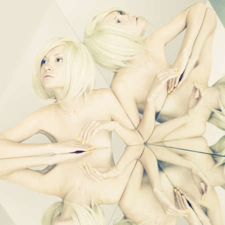 Sensual young blonde in kaleidoscope of reflections photo