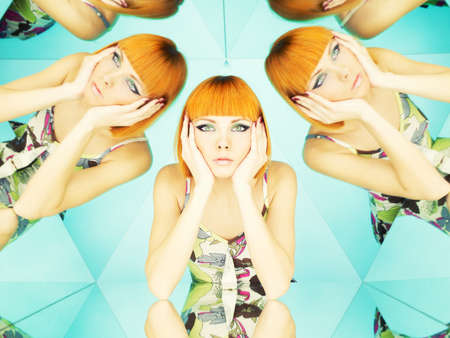 aquamarin: Bright young redhead woman in kaleidoscope of reflections