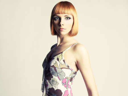 Young beautiful redhead girl with a bob haircut Stock Photo - 12609755