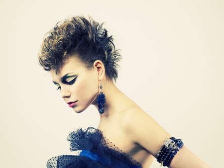 Fashion portrait of a beautiful young lady of punk photo