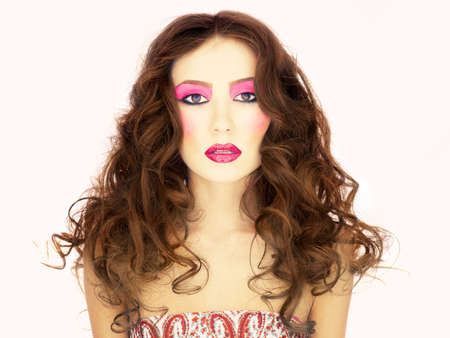 Photo of young beautiful woman with bright make up photo