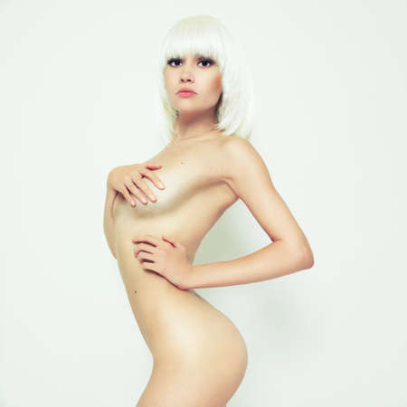 Studio fashion photo of elegant naked lady photo