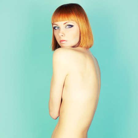 skinny girl: Beautiful flexible redhead girl with a bob haircut Stock Photo