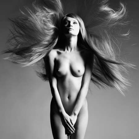 sexy naked woman: Fashion photo of beautiful nude woman with magnificent hair Stock Photo