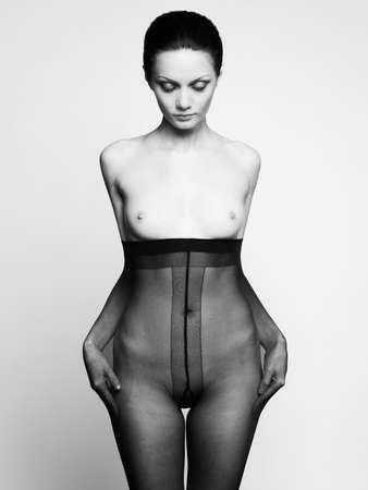 Elegant nude woman in pantyhose. Fashion art photo Stock Photo