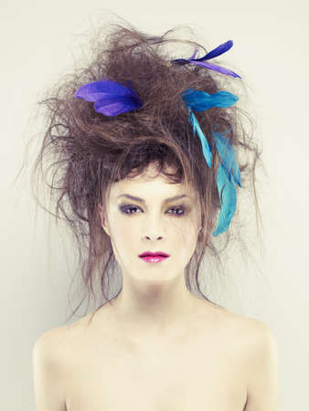 fine art portrait: Beautiful young woman with an unusual hairstyle