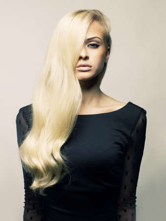 Photo of young beautiful lady with magnificent blond hair photo