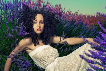 fairy woman: Beautiful sensual lady lying in fairy lavender flowers