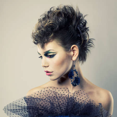 Fashion portrait of a beautiful young lady of punk photo