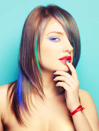 Photo of young lady with bright makeup on bright background photo