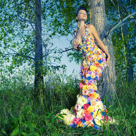 Fashion photo of beautiful lady in dress of flowers 版權商用圖片