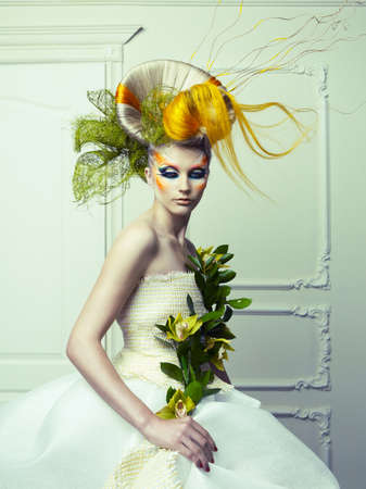 Lady with avant-garde hair and bright make-up photo