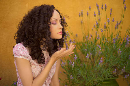 Portrait of beautiful young lady with lavender flowers