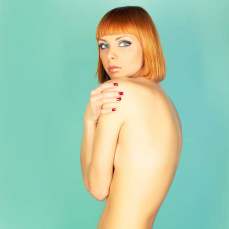 Beautiful flexible redhead girl with a bob haircut Stock Photo - 15290910