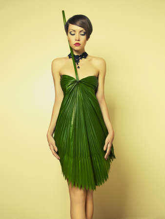 Beautiful stylish lady in an unusual dress of Palme photo