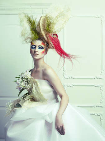 Lady with avant-garde hair and bright make-up Stock Photo - 16333305