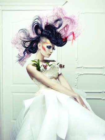 Lady with avant-garde hair and bright make-up 版權商用圖片
