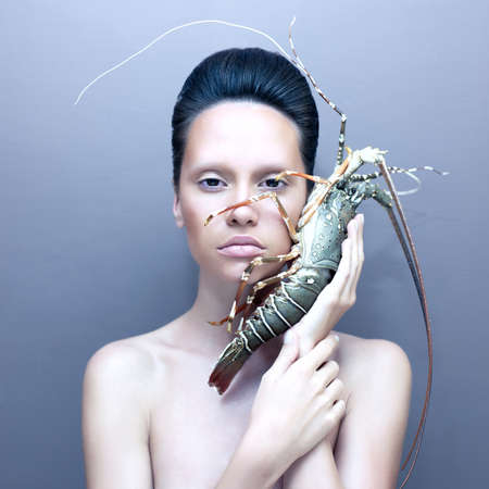 Surreal portrait of young unusual lady with lobster  Stock Photo - 16854802
