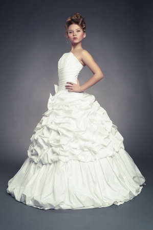 waltzing: Girl princess in white ball gown on black background