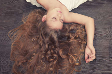 Portrait of beautiful sleeping girl with curly hair photo
