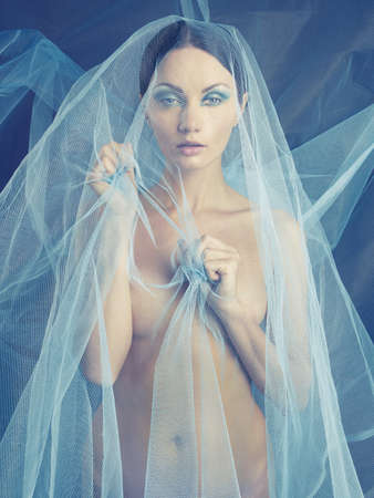 Sensual beautiful nude woman under the blue veil Stock Photo - 17345198
