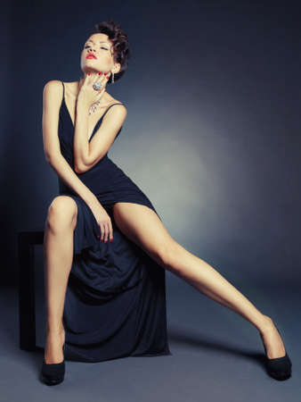 Fashion of beautiful lady in elegant evening dress photo