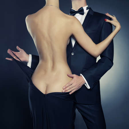 erotic dress: Conceptual of sexy elegant couple in the tender passion