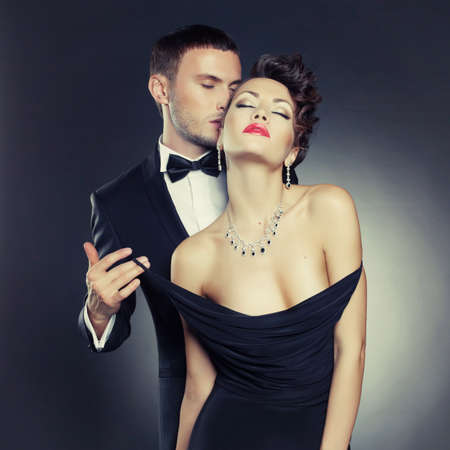 Fashion photo of sexy elegant couple in the tender passion photo