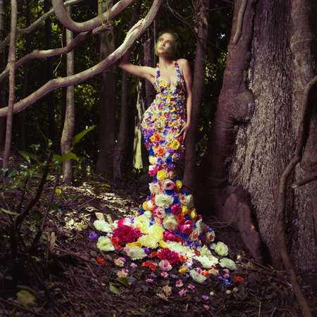 nymph: Blooming gorgeous lady in a dress of flowers in the rainforest Stock Photo