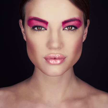 Fashion photo of beautiful lady with bright make-up photo