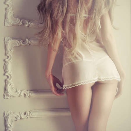 naked woman back: Fashion art photo of young sensual lady in classical interior