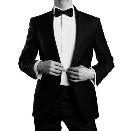 bowtie: Photo of stylish man in elegant black suit