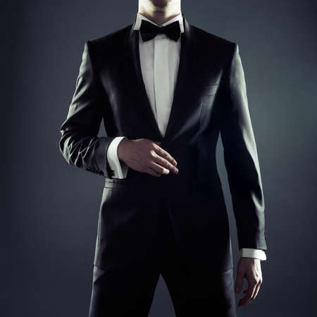 only young men: Photo of stylish man in elegant black suit