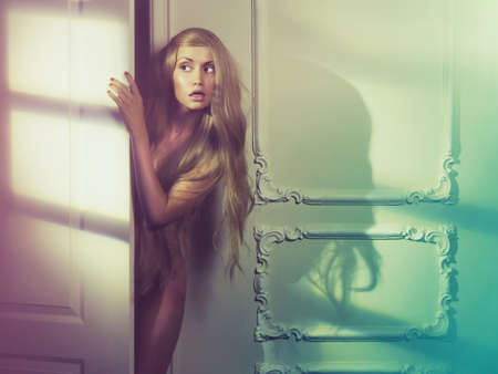 sexy woman nude: Fashion art photo of young sensual lady in classical interior