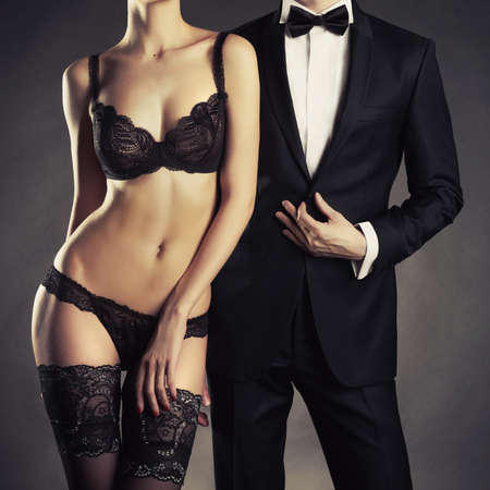 erotic couple: Art photo of a young couple in sensual lingerie and a tuxedo Stock Photo