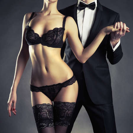 nude art model: Art photo of a young couple in sensual lingerie and a tuxedo Stock Photo