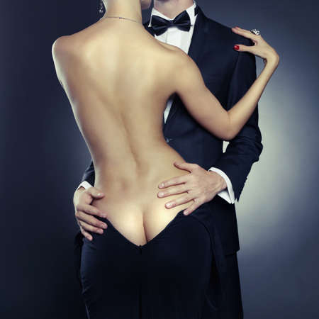 Conceptual photo of sexy elegant couple in the tender passion Фото со стока